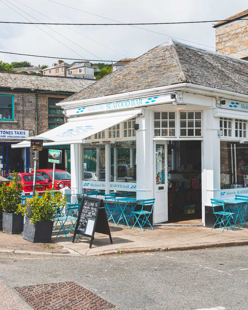 The outside seating area of Mackerel Sky Seafood Bar in Newlyn, Cornwall