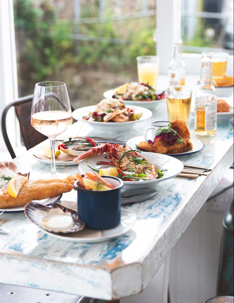Lobster, drinks and a selection of seafood dishes.