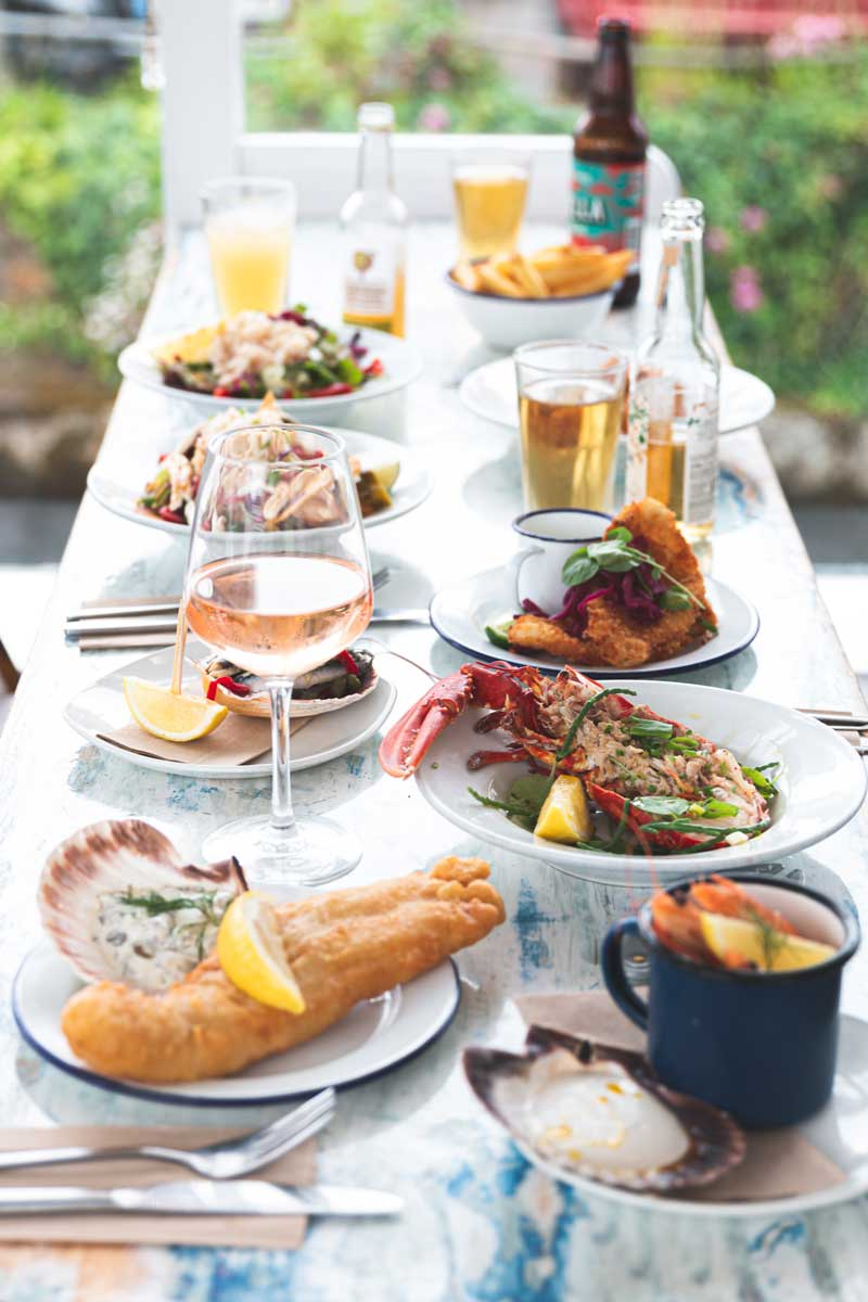 A selection of seafood dishes and drinks inside the restaurant.